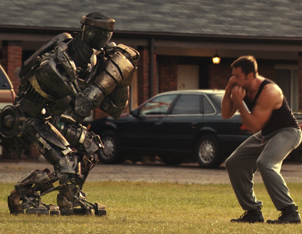 Hugh-Jackman-with-star-robot-Atom-in-Real-Steel.jpg