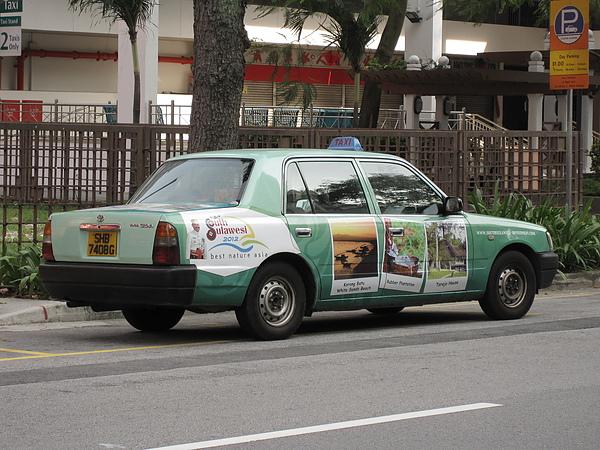 貼滿廣告的計程車.JPG