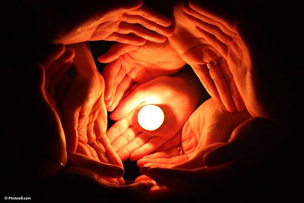 candle_surrounded_with_many_hands-other