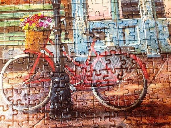 歐布蘭畫中常見的紅色腳踏車